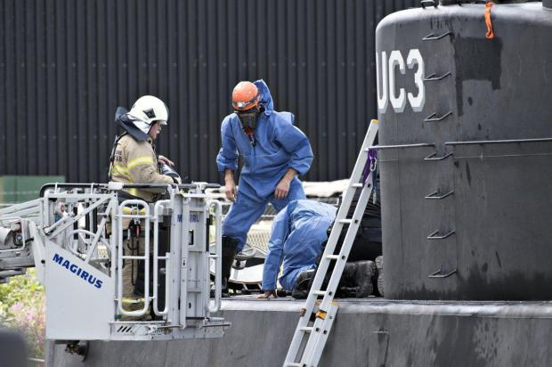 Danish police technicians investigate the recovered privately owned submarine Nautilus.jpg