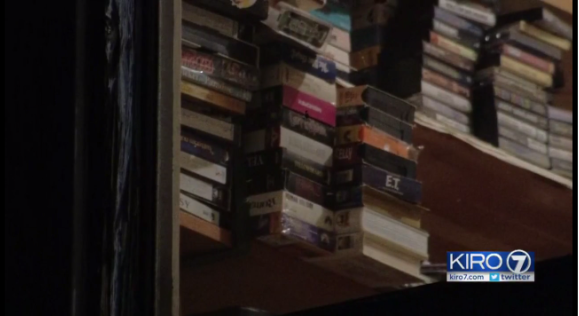 Stacks of Child exploitatin materials in the Emery's house.png