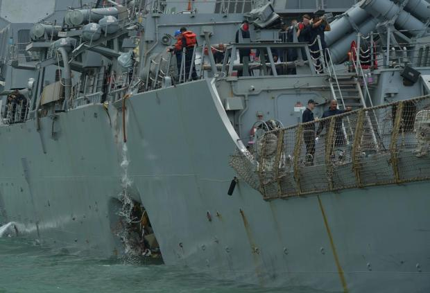 USS John S McCain has a hole on the port side of its hull 1