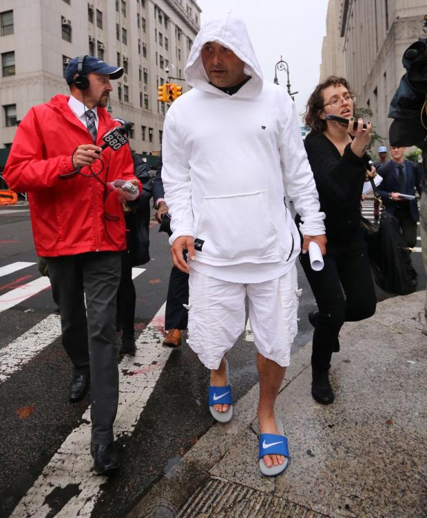 Craig Carton leaves federal court after his arraignment Aug 6
