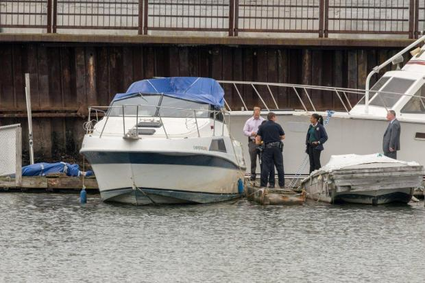 Police find Carmine Carini's body wrapped in a tarp and chained to a cinder block 3