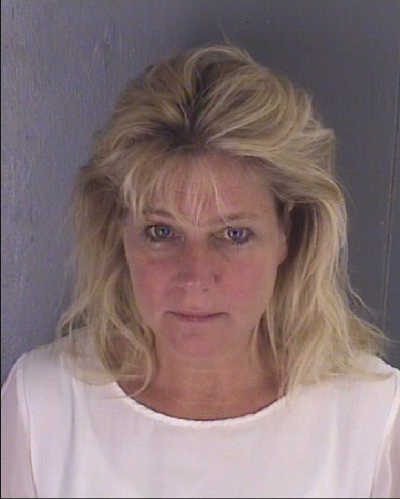 Soire with the inmate!! Teresa Burchfield, 53, wife of Trump lawyer, arrested for allegedlly having sex with inmate, in a parking lot