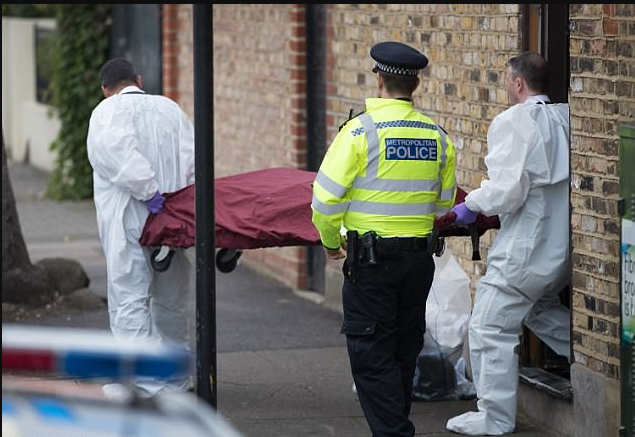The body presumed to be Sophie Lionnet being taken for examination