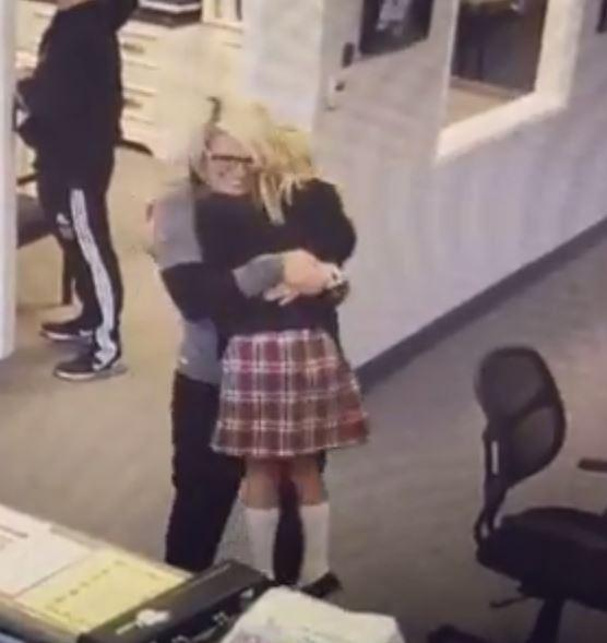 Tannah Butterfield, 11, jumped straight into the arms of school office worker Jackie Alexander